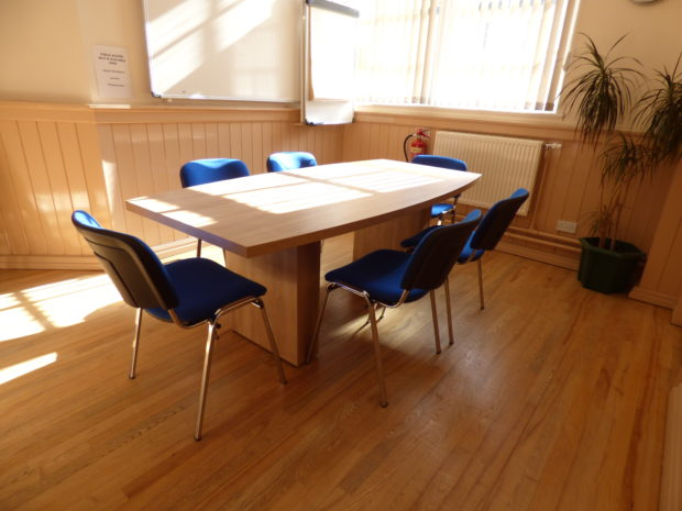 Town Hall Meeting Room with large table, 6 chairs and whiteboard